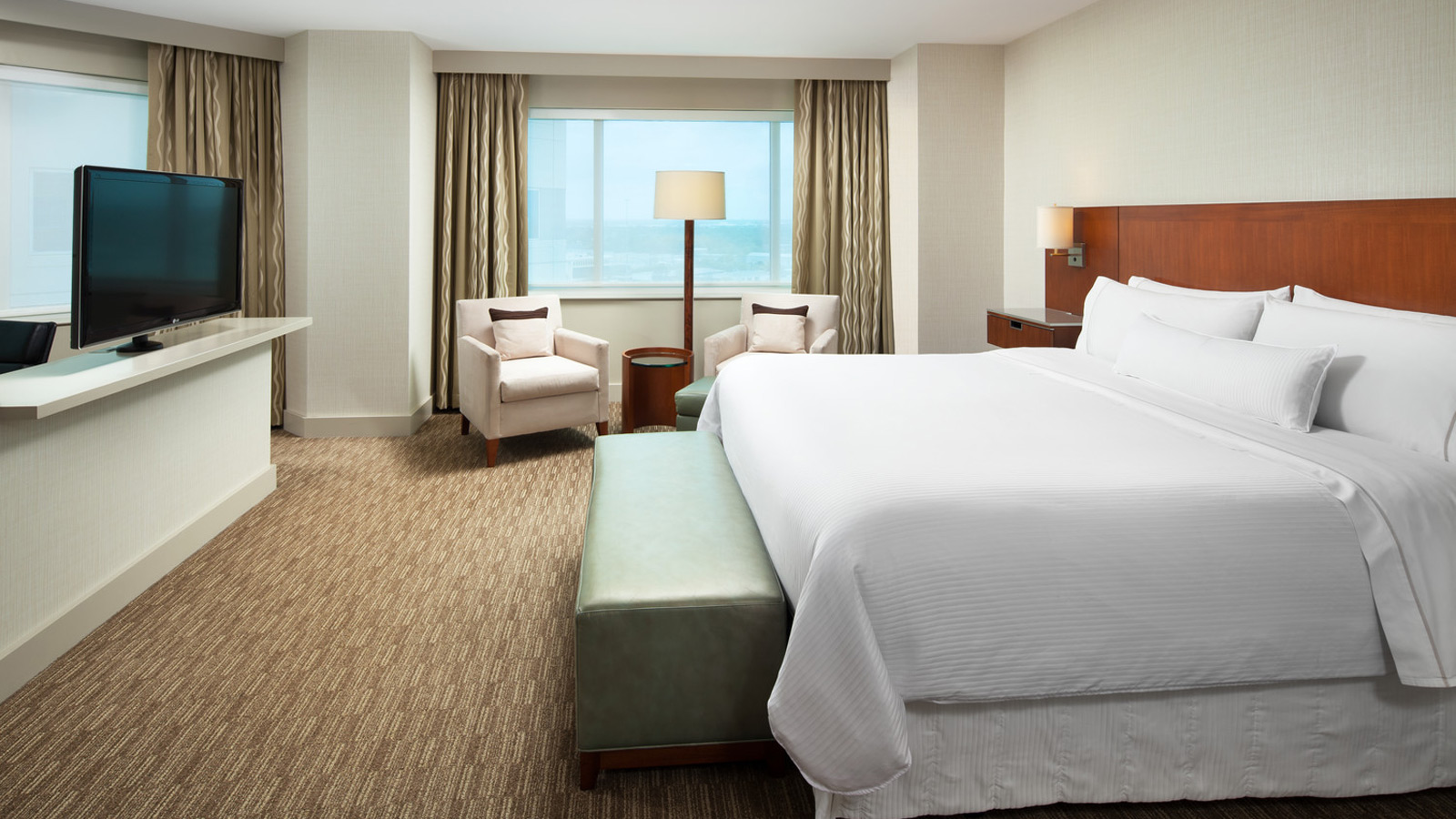 A modern and spacious Deluxe Room at The Westin Houston, Memorial City.