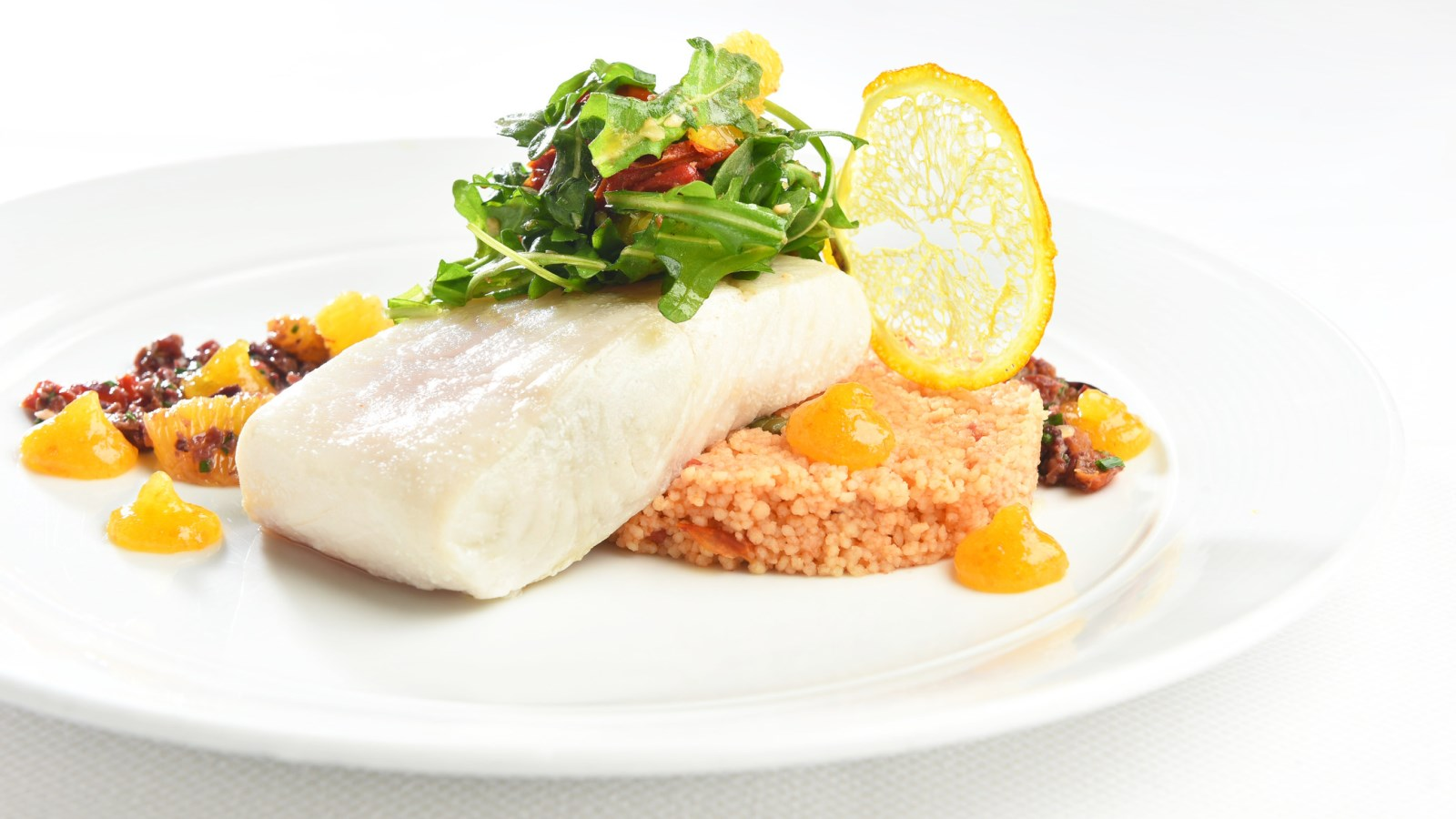 Expertly cooked Halibut - an example of the sophisticated fare you can expect at the Westin Houston, Memorial City.